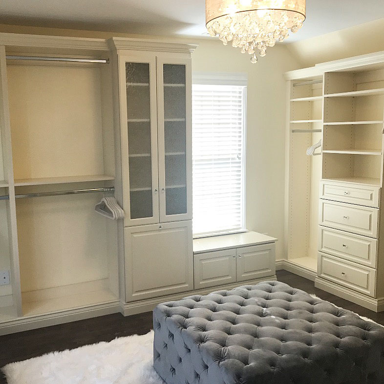custom closet with glass cabinets