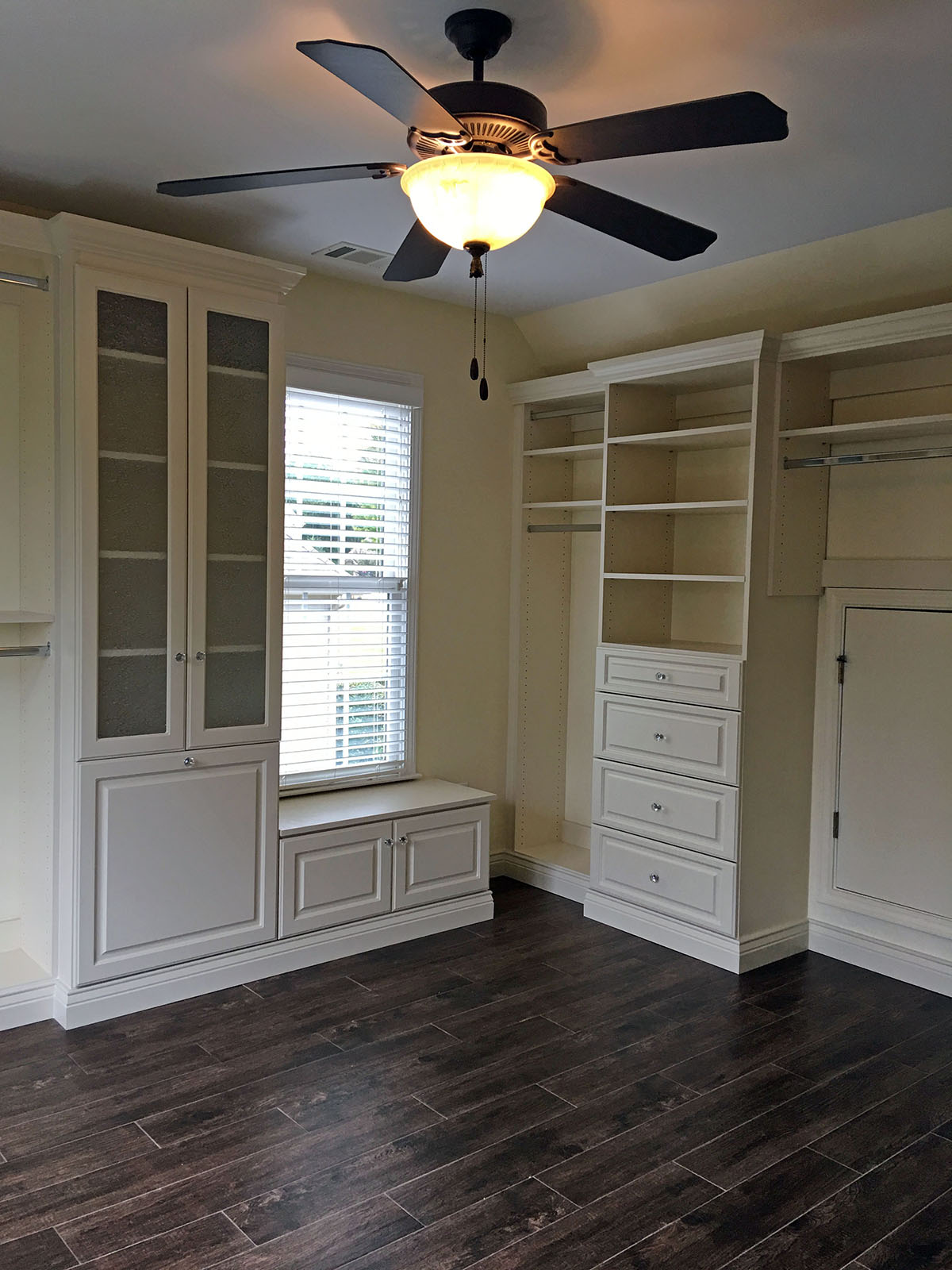 custom closet with seating area