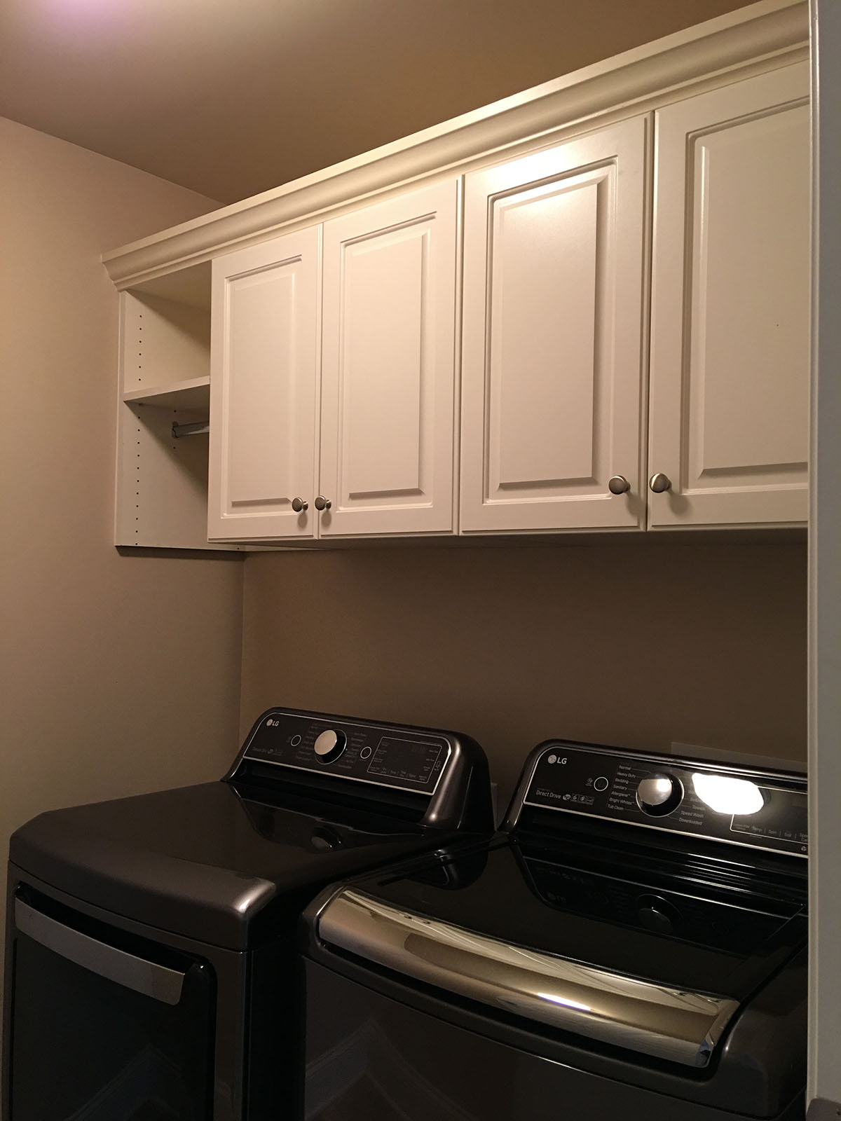 laundry room cabinets with clothing rod