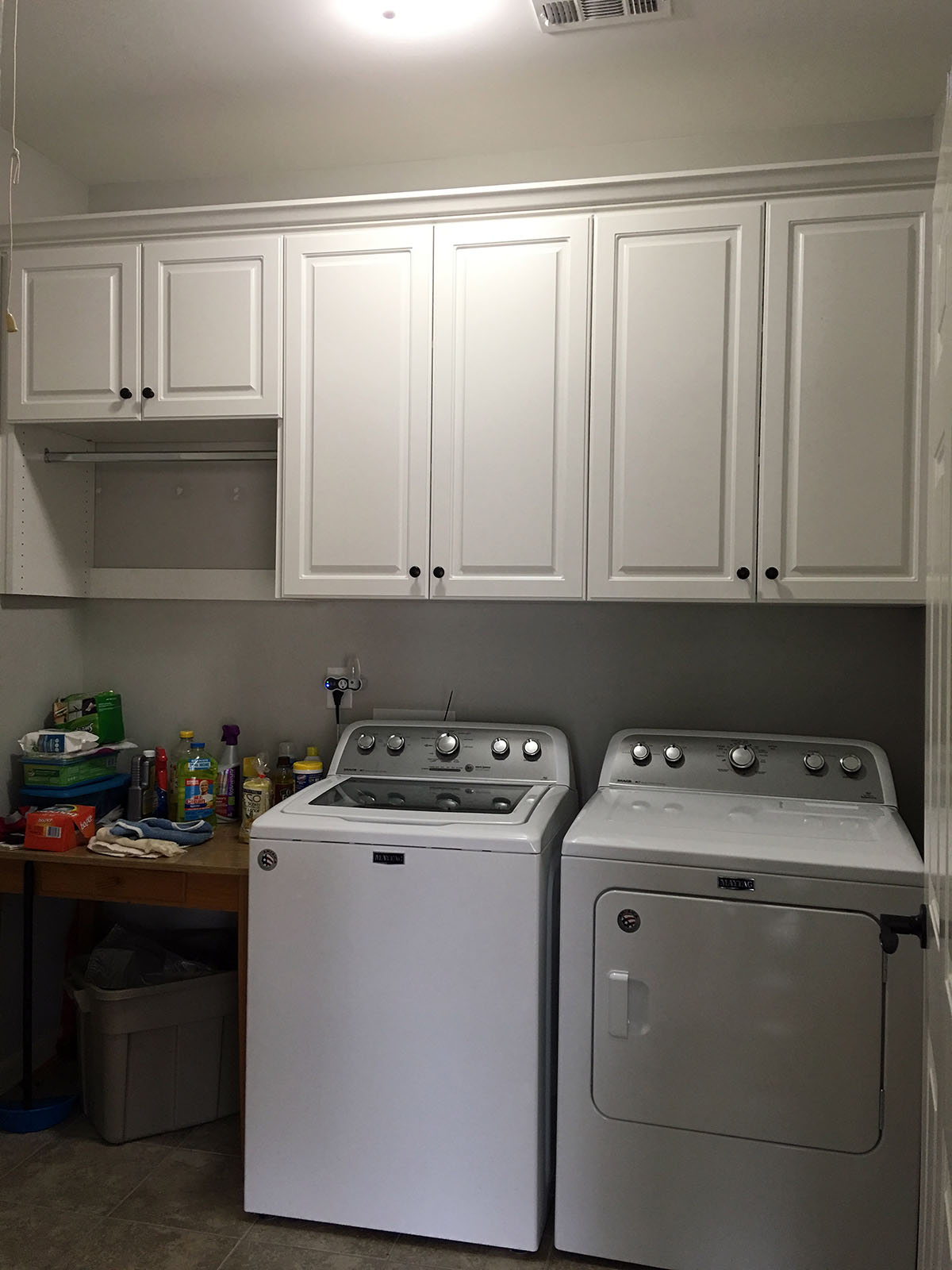 laundry room storage with wardrobe rod